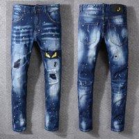 óleo de itália venda por atacado-Novo Itália Estilo # 3314 # Olhos Amarelos dos Monstros Angustiados dos homens Bordados Calças Oleosas Azul Jeans Skinny Calças Finas Tamanho 29-40