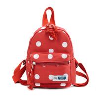 pontos de mochilas venda por atacado-Moda Selvagem das Crianças Polka Dots Sacos de Ombro Personalidade Na Moda Bonito Ao Ar Livre Viajar Mochilas de Lona Mochilas Casuais Multi Cores