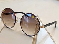 rodada de óculos populares venda por atacado-GEMA Moda Designer de Luxo Óculos Brilhante Chip Plate Charme Quadro redondo Top Qualidade UV400 Lente Espelho Popular Glasse Removível Com Caixa
