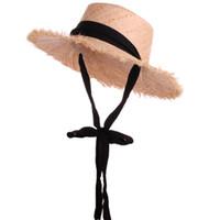 sombreros de paja hechos a mano al por mayor-Tejido hecho a mano 100% Rafia Sombreros para el sol para mujer Cinta negra Cordones Sombrero de paja de ala grande Sombrero de paja al aire libre Playa Chapeu Feminino