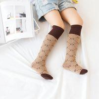 rodilla bebé calcetines para niño al por mayor-Calcetines de diseñador de lujo Medias Calentadores de piernas unisex Niños bebés niñas Niños Calcetines hasta la rodilla Calcetines para rodilleras para niños Calcetines para hombres 35CM WZ006