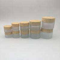 kavanoz krema kap toptan satış-Ahşap tahıl Kapak ile buzlu Cam Krem Kavanoz Makyaj Cilt Bakımı Losyon Pot El Yüz Kremi Şişesi 5g-10g-15g-30g-50g Kavanozlar