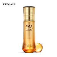 ingrosso capelli dell'olio marocchino-LUODAIS 80mL NO.5 Profumo Lascia-In Cura dei capelli Olio essenziale Nutriente Marocco Argan Siero per capelli Shampoo all'ingrosso