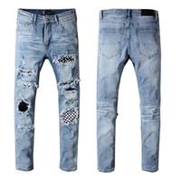 siyah pantolon yeni moda erkekler toptan satış-Erkek Tasarımcı Pantolon Yeni Moda Marka Erkekler Siyah Kot Sıska Yırtık Erkek Tasarımcı Kot Denim Motosiklet Biker Pantolon ...
