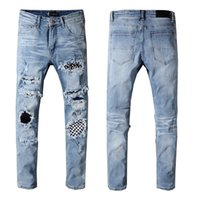 homens nova moda jeans preto venda por atacado-Mens Designer Calças Nova Marca de Moda Homens Calça Jeans Skinny Rasgado Mens Designer Jeans Denim Motociclista Calças Jeans Mens