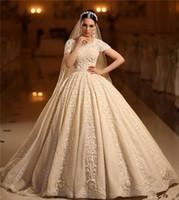 sexy indien kleid großhandel-2020 Luxus Perlen Ballkleid Brautkleider Vintage Champagner kurzen Ärmeln Indien Saudi Arabisch Dubai Plus Size Brautkleid