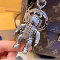 Wholesale universal car keychain resale online - Luxury keychain Designer Fashion Famous Luxury Astronaut pendant Car Keychain Women Bag Charm Pendant Accessories Birthday Gift Key Holder