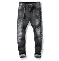 jeans rotos parcheados para hombre al por mayor-Único Cinta para hombre Con paneles Pantalones Vaqueros negros ajustados Diseñador de moda Slim Fit Washed Motocycle Denim Pantalones Parches Hip HOP Pantalones 1011