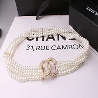 vestidos de cadena al por mayor-Cinturón de perlas en forma de X hebilla en forma de cinturón decorativo para damas casual versión coreana simple del cinturón elástico con cuentas hebilla vestido AD02A