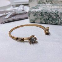bronce titanio al por mayor-Nuevo diseñador de pulsera para mujer y mujer de acero de titanio de apertura de diamante de bronce pulsera de lujo joyería casual