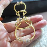 orejera india oro al por mayor-Línea de aro de piedra de circón cúbico de diseño de alta calidad Pendientes de oreja con círculo Joyas de fiesta chapadas en oro amarillo profundo de 18 quilates Sin desvanecimiento para mujeres