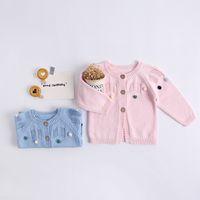 bebek yün kazakları toptan satış-INS bebek çocuk giyim kazak Hırka düğmeleri ile Yuvarlak Yaka kazak Küçük Yün topları Ile Butik kız bahar güz kazak