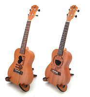 Wholesale 23 inch guitar for sale - Group buy 2019 new inch ukulele Sapele four string small guitar cartoon beginner entry instrument