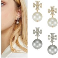 Wholesale connected jewelry for sale - Group buy Brand name brass material hollow stereoscopic connect pearl with diamond for women drop earrings jewelry PS6704A