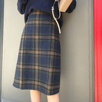 334e39e16b Autumn and winter new Korean version retro high waist large size plaid wool  skirt female students thickened in the long
