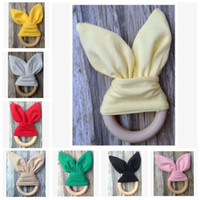 Wholesale toy ears resale online - Baby Teeth Training Toys Gifts Baby Teething Ring Rabbit Ear Chew Teether Safety Natural Wood Teether Big Bow Nursing Holder Bunny Ear E455