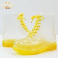 botas de goma para mujer al por mayor-atados-Cruz punta redonda Mujeres caucho sólido impermeable Rainboots tobillo Bling PVC antideslizante botas de lluvia zapatos de cordones planos