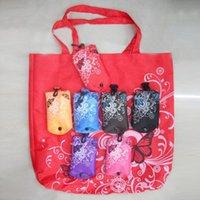 faltbare tuchaufbewahrung großhandel-Faltbare handliche einkaufstaschen 210d oxford tuch schmetterlinge blumen gedruckt tragbare aufbewahrungsbeutel heißer verkauf 2 6ya e1