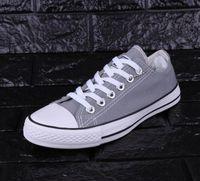 ingrosso scarpe da corsa donna scarso-Scarpe Running uomini bassi di prezzi di fabbrica Nuovo unisex Top adulti delle donne allacciate scarpe casual scarpe da tennis EUR35-46