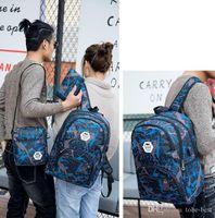 mochila com saco de corda estilo esportivo venda por atacado-2020 barato ao ar livre sacos de viagem camuflagem mochila computador bag cadeia Oxford Brake ensino médio saco estudante muitas cores