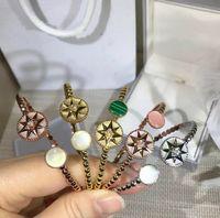 ручной браслет модели оптовых-European designer ROSE DES VENTS bracelet Compass rose star Open hand bracelet letter C D Modelling women luxury bracelet Valentine gift