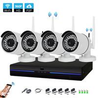 h 264 dvr cctv systems al por mayor-Nuevo hogar Sistema de seguridad CCTV inalámbrico de 4 canales 960P NVR 4PCS 1.3MP IR al aire libre P2P Wifi IP CCTV Sistema de cámara de seguridad Kit de vigilancia