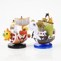 ein stück boot modell großhandel-Action Spielzeugfiguren 2 Stile Neue Heiße Spielzeug One Piece Going Merry Thousand Sunny Piratenboot Modell Mini Figur Schiff Sammlerpuppe