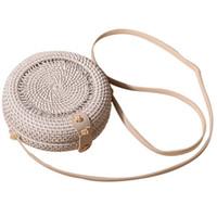 weiße handgefertigte taschen großhandel-Weiße hohle Rattan Tasche Bali böhmischen Frauen Vintage Stroh Strand Handtasche Mini Runde Umhängetasche Handgemachte Schultertaschen