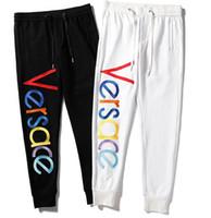 pantalones para correr pantalones al por mayor-más nuevos pantalones de hip hop hombres basculadores de las mujeres ocasionales de los pantalones Harem pantalón deporte de los hombres mapa Bottoms pista de entrenamiento activan los pantalones
