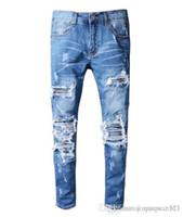 джинсы с голубыми джинсами оптовых-Новая Италия Стиль Мужские змейки Вышивка Проблемные Патчи Кожа Скрытность Брюки Тощий синие джинсы Тонкий брюки Амири вышитые джинсы 00
