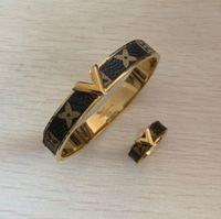 anéis de couro para homens venda por atacado-Alta qualidade em aço inoxidável 316L moda top marca conjuntos de jóias anéis e pulseiras pulseiras pulseiras de couro mulheres / homens Christmsa presente