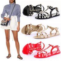 zapatos planos de estilo europeo al por mayor-Estilo europeo Nuevo Verano Sandalias de Gladiador Planos Zapatos Para Mujer Remache Zapatos de playa de la jalea Sandalias de las mujeres ADF-6978