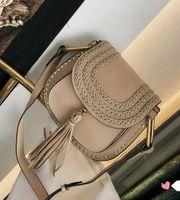Wholesale cowhide saddle resale online - Classic Vintage Woven Saddle Bag Women Handbags Purses Suede Braided Cowhide Rivet Tassel Shoulder Bags Crossbody Messenger bag