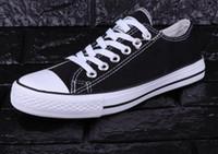 zapatos casuales de tela plana al por mayor-Más colores Nuevos planos unisex para mujeres y para hombres Zapatos de tela ocasionales con cordones Zapatillas de deporte Zapatillas par 35-45 EUR