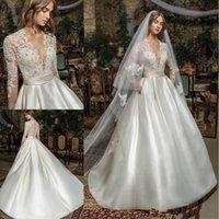 Wholesale bridal neck flower resale online - 2020 fashion Boho Modern Long Sleeve Princess Wedding Dresses V Neck Covered Button Backless Lace Train Bridal Gowns Vestido de Novia