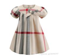 vestidos de moda coreana para niños al por mayor-2019 NUEVA Moda Popular Vestido de las niñas de manga corta a cuadros patrón diseñador verano estilo coreano delantal ropa de los niños vestido