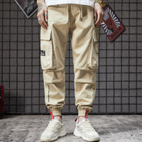Wholesale large pocket cargo pants for sale – dress Spring Trend Locomotive Loose Bottom trousers Japanese Cargo Men s Large Pocket Large Size Workwear Pants and Small man pant designing