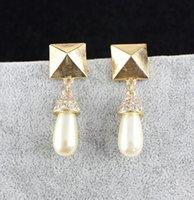 metal pavé cuentas de cristal al por mayor-Grano de la perla de la moda pendientes de gota pavimentada cristal sólido cuelga los pendientes de la aleación del metal de la joyería para las mujeres