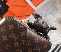 calidad del bolso del diseñador al por mayor-Llaveros de lujo Diseñador Llavero Hebilla Monedero Bolsas colgantes Diseño de perro Muñeca Cadenas Elegante Hebilla clave 6 colores Alta calidad con caja Opcional