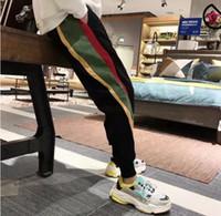 calças de veludo de corda venda por atacado-Homens e mulheres novas calças de veludo cotelê calças feixe primavera e verão tendência solta pés Harlan calças masculinas hit cor selvagem nove calças 501
