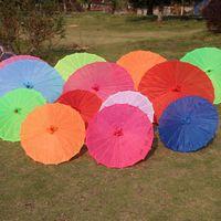 ingrosso ombrelli di seta-2019 Parasole cinese in tessuto colorato Ombrello bianco rosa Cina Tradizionale colore ballo Parasol Puntelli in seta giapponese