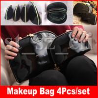 conjunto de bolsa de viaje cosmética al por mayor-Famoso maquillaje Bolsas de cosméticos Organizador Maquillaje Bolsa de viaje Bolsa de viaje Maquillaje Bolsa Cluch Monederos Organizador Bolsa de aseo 4 unids / set