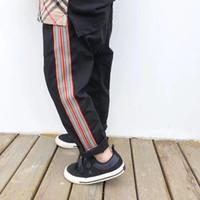 pantalón pantalón negro para niñas al por mayor-Nuevos niños Ropa de bebé Otoño Invierno Niños Niños niñas Retro Caqui y negro Pantalones casuales Pantalones rectos