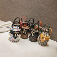 mini cubo de regalo al por mayor-Niños Diseñador Bolsos Moda Chicas Coreanas Mini Princesa Monederos Patrón Clásico Impreso Cubo Bolsas de Hombro Niños Caramelo Monedero Regalos