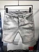 jeans stretch branco venda por atacado-2019 Mens Emblema Rasga Stretch branco Jeans Moda Designer Slim Fit Lavado Motocycle Calças Jeans Painted Hip Hop Calças