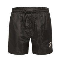 ingrosso milan fashion black-Global Summer Milan Fashion Men Beach Shorts Cotone di alta qualità Ragazzi pantaloni corti pantaloni da bagno Costumi da bagno tronchi nero