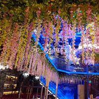 décoration de mariage jardin rose violet achat en gros de-12 pcs Suspendus Artificielle Longue Glycine Faux Jardin Fleurs Vignes En Plein Air Plantes Accueil Décoration De Mariage Blanc Rose Pourpre