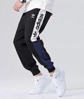 calça de jogger venda por atacado-Nova Marca de Moda Calças Para Calças de Treino Dos Homens Calças Corredores Com Letras AD Primavera Homens Sweatpants Com Cordão Stretchy Corredores de Roupas Por Atacado