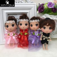 Wholesale couple figures for sale - Group buy 12cm Couples Ddung Dolls With Bowknots Pure Color Handmade Child Doll Wedding Decoration Toy New Arrival xy E1
