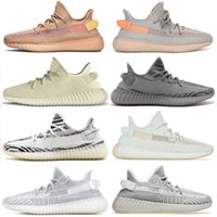 Wholesale beige lace boots for sale - Group buy Black Kanye men shoes Glow Cream White Zebra Blue Tint women sport Running shoes Antlia luxury designer Sneaker boots Size